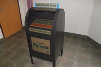 Take it to the Box drop box in the Law Enforcement Center Lobby