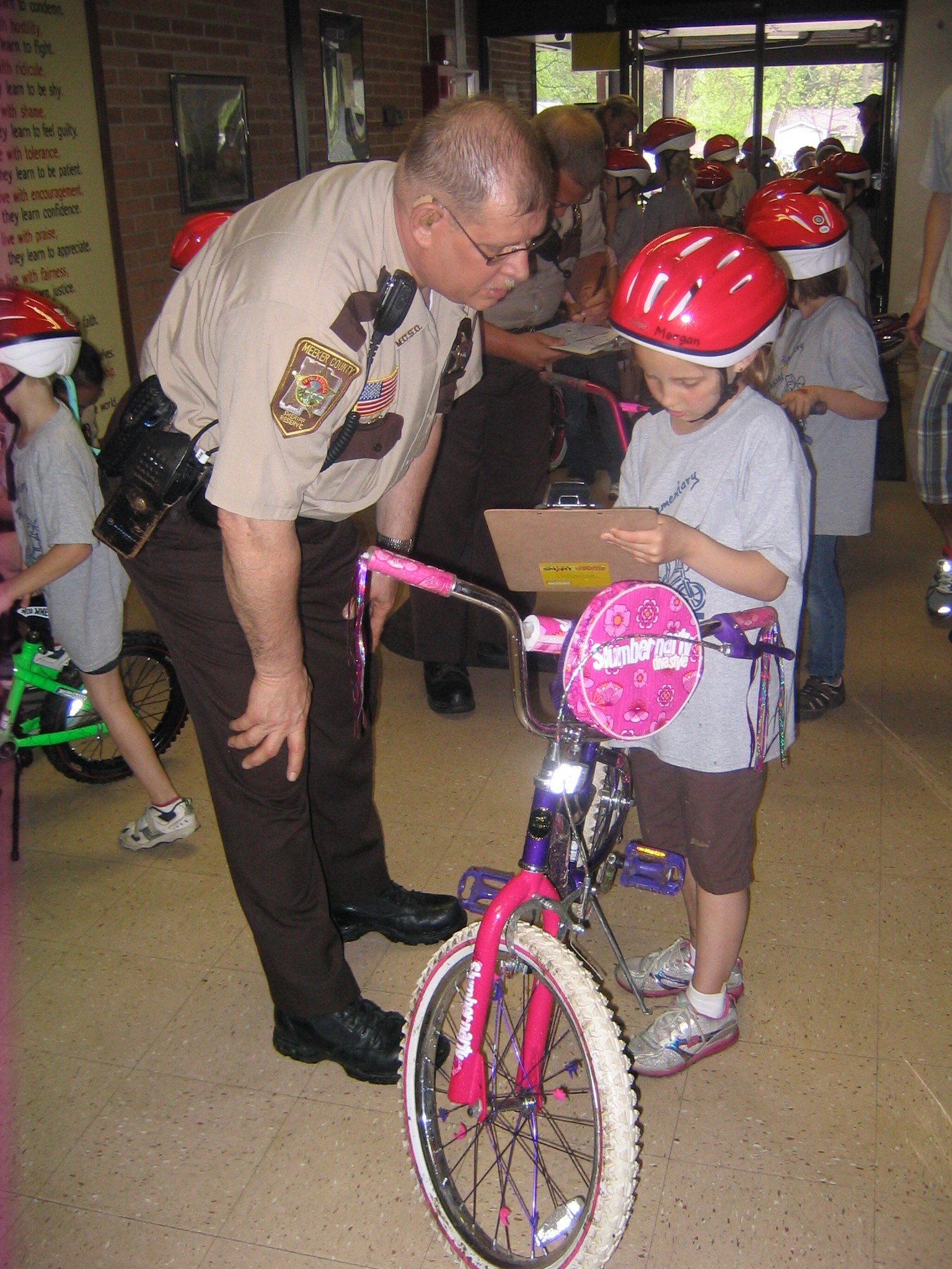 Sheriff Reservist with a Rider and Her Bike at Bike Rodeo May 20, 2011