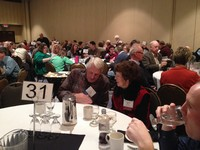 Darlene Miller and Fred Behnke visit at the Outstanding Conservationist luncheon.