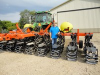 Grimsgard is pictured here with his new strip till machine.